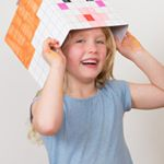 Child laughing putting on a BoxHead