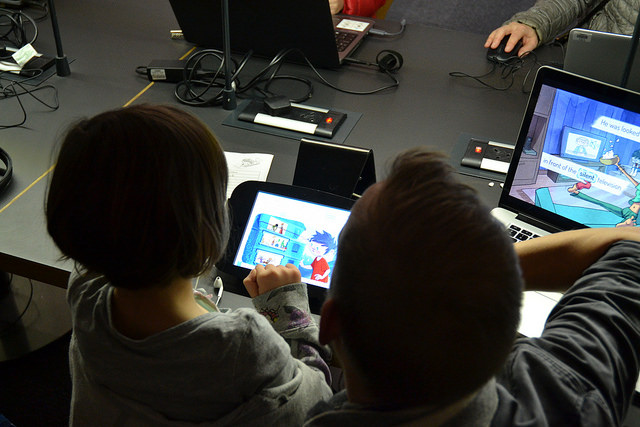 Adult and Child play digital games at WordPlay 2016