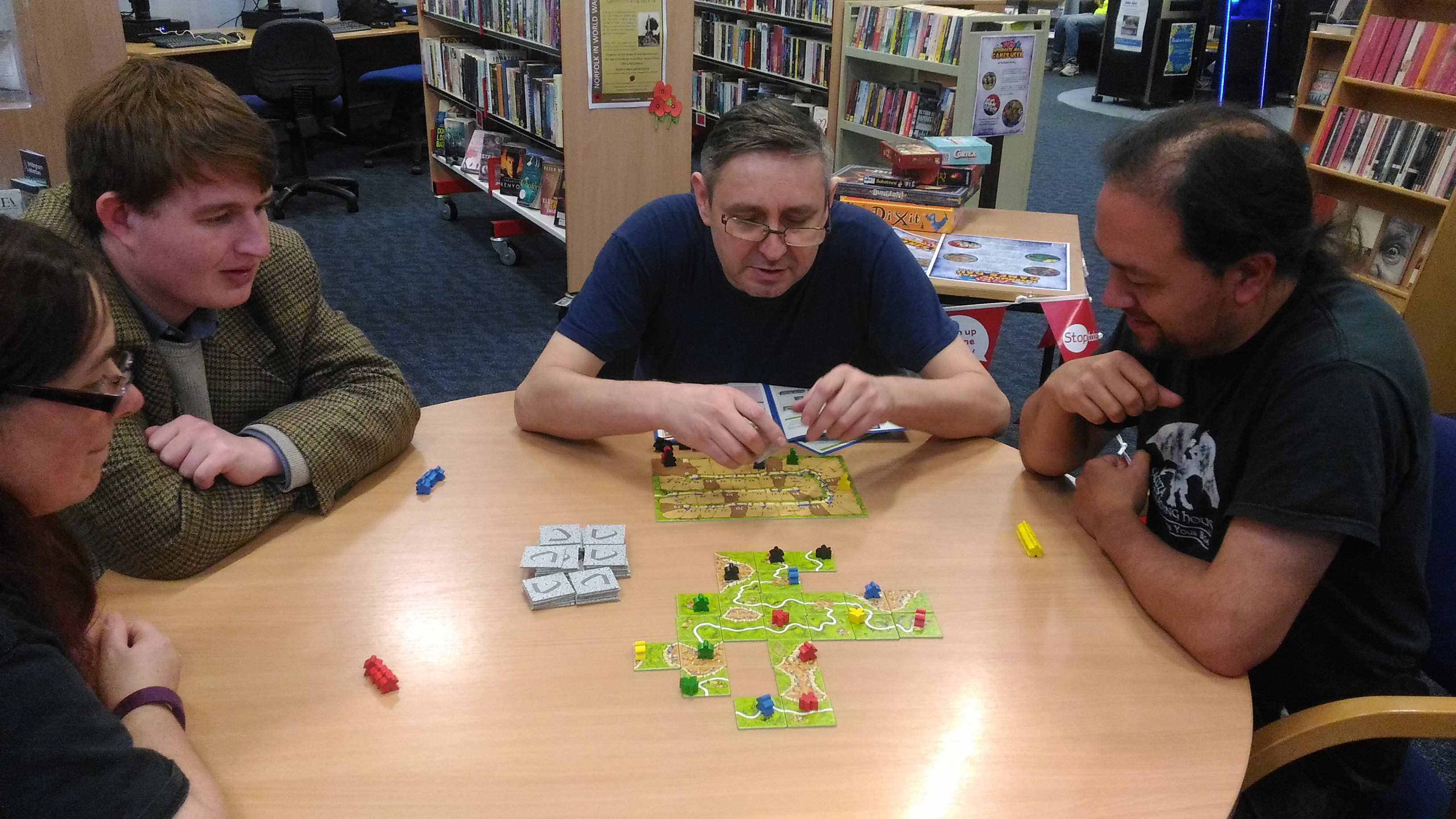 Library users playing Carcassonne