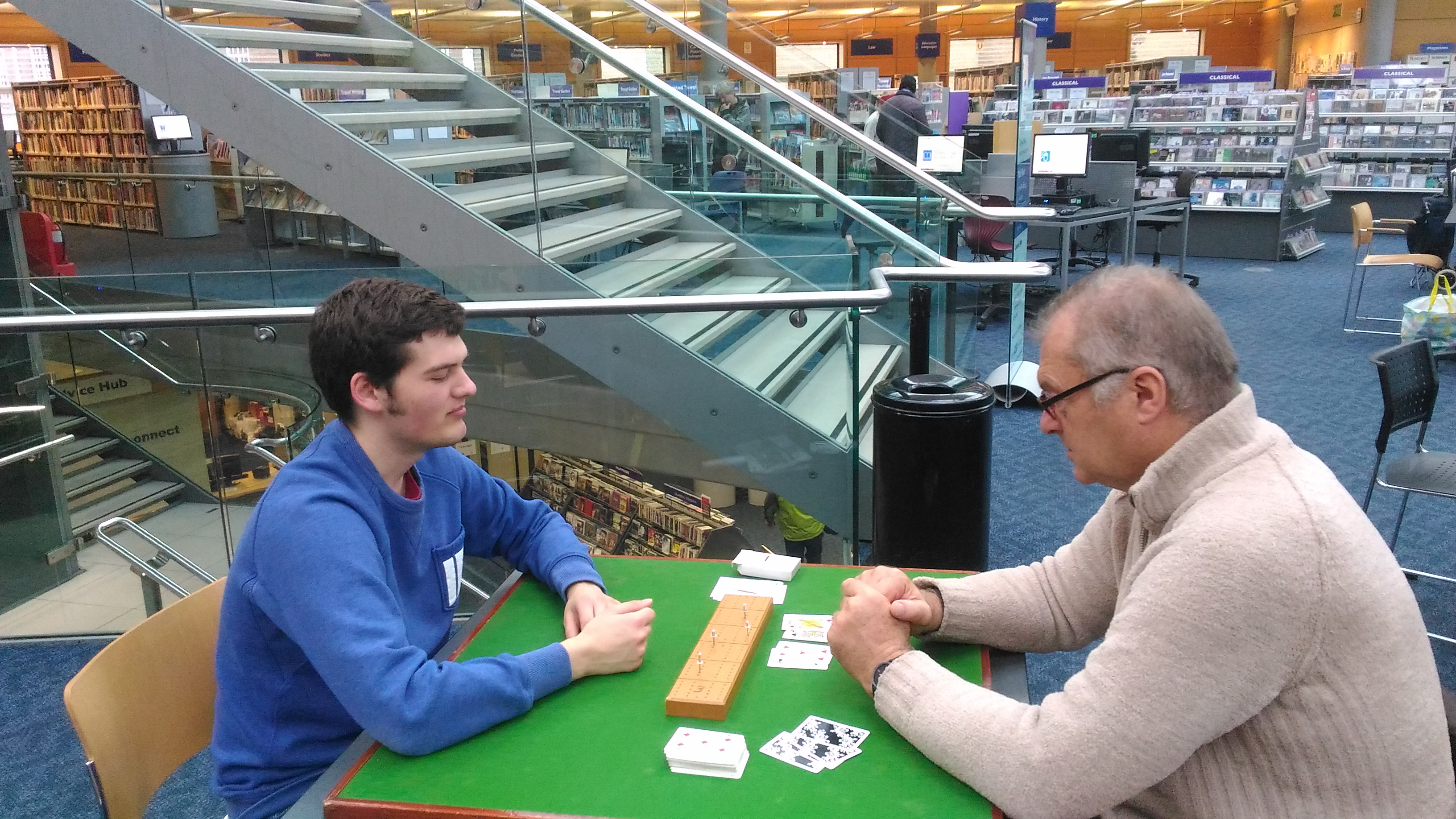 Library users playing cards