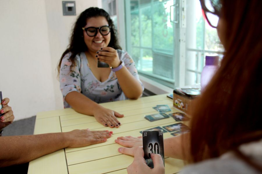 "Photo of people playing ""The Mind"" card game"